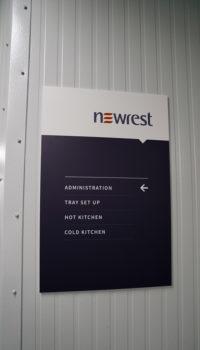 Newrest Group rectangular sign