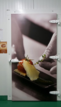 newrest photo of someone adding a garnish to food